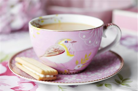 pink - Close up of cup of tea and cookie Stock Photo - Premium Royalty-Free, Code: 649-06112841