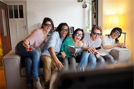entertainment - Friends watching 3D movie in living room Stock Photo - Premium Royalty-Free, Code: 649-06112949