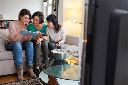 Women using tablet computer on sofa Stock Photo - Premium Royalty-Free, Code: 649-06112953