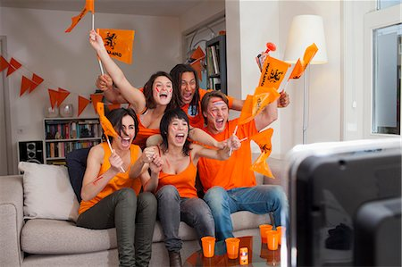 Friends watching sports on television Stock Photo - Premium Royalty-Free, Code: 649-06112975