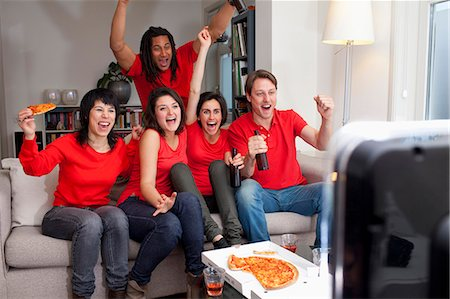 Friends watching sports on television Stock Photo - Premium Royalty-Free, Code: 649-06112971