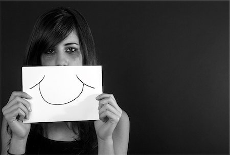 silhouette black and white - Crying teenage girl holding fake smile Stock Photo - Premium Royalty-Free, Code: 649-06113066