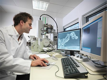 Scientist working on computer in lab Stock Photo - Premium Royalty-Free, Code: 649-06113276