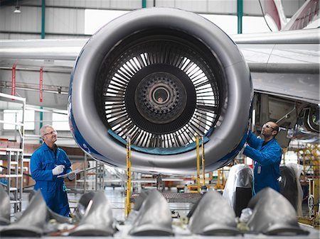 Workers examining airplane engine Stock Photo - Premium Royalty-Free, Code: 649-06113325