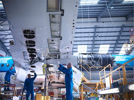 Workers examining airplane machinery Stock Photo - Premium Royalty-Free, Code: 649-06113350