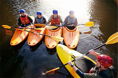 Teacher talking to students in kayaks Stock Photo - Premium Royalty-Free, Code: 649-06113544