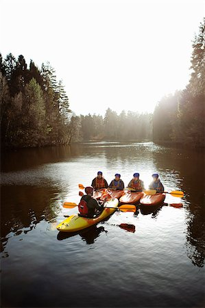 Teacher talking to students in kayaks Stock Photo - Premium Royalty-Free, Code: 649-06113545