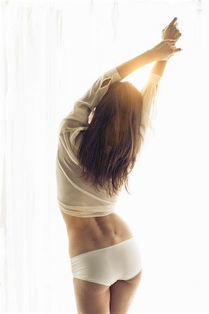 Woman posing in shirt and panties Stock Photo - Premium Royalty-Free, Code: 649-06113561