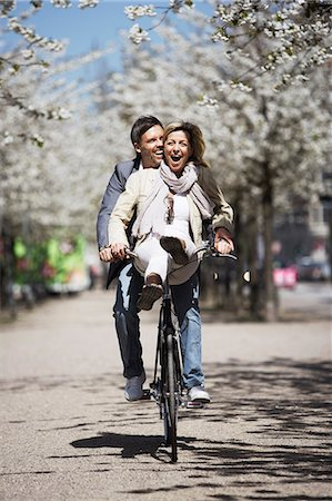 Man riding with girlfriend on bicycle Stock Photo - Premium Royalty-Free, Code: 649-06113638