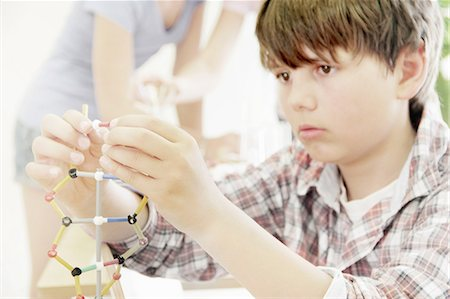 Boy making molecular model in class Stock Photo - Premium Royalty-Free, Code: 649-06113729