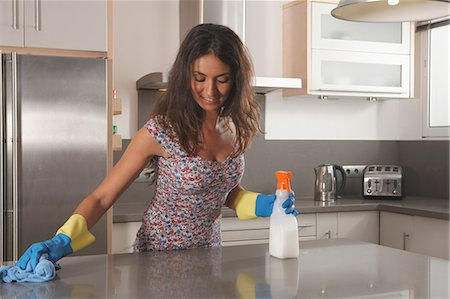 Woman cleaning kitchen counter Stock Photo - Premium Royalty-Free, Code: 649-06113766