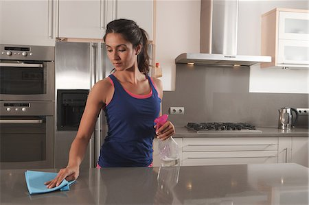 Woman cleaning kitchen counter Stock Photo - Premium Royalty-Free, Code: 649-06113767