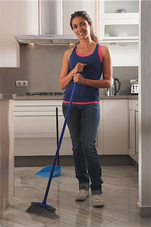 Smiling woman cleaning kitchen floor Stock Photo - Premium Royalty-Free, Code: 649-06113768