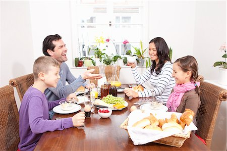 family table eating together - Family eating breakfast at table Stock Photo - Premium Royalty-Free, Code: 649-06113820
