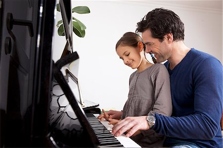 Father and daughter playing piano Stock Photo - Premium Royalty-Free, Code: 649-06113841