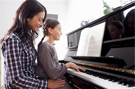 Mother and daughter sitting at piano Stock Photo - Premium Royalty-Free, Code: 649-06113843