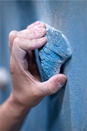 Close up of a climbers hand on an artificial handhold at a climbers gym Stock Photo - Premium Royalty-Free, Code: 649-06113913