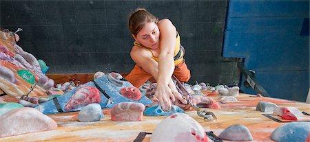 Woman climbing indoor rock wall Stock Photo - Premium Royalty-Free, Code: 649-06113921