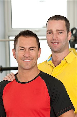 Trainer and client laughing in gym Stock Photo - Premium Royalty-Free, Code: 649-06113936