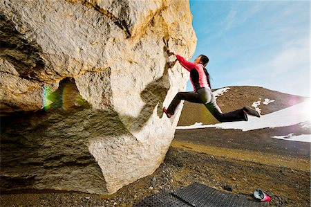 Woman bouldering in Josepsdalur, Iceland Stock Photo - Premium Royalty-Free, Code: 649-06113931