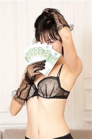 Woman in lingerie holding Euros Stock Photo - Premium Royalty-Free, Code: 649-06164318