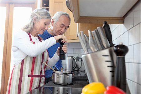 Older couple cooking together in kitchen Stock Photo - Premium Royalty-Free, Code: 649-06164497