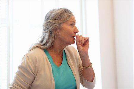 people coughing or sneezing - Older woman coughing into her hand Stock Photo - Premium Royalty-Free, Code: 649-06164507
