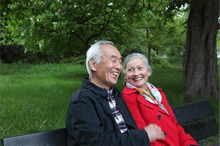 Older couple sitting on park bench Stock Photo - Premium Royalty-Free, Code: 649-06164517