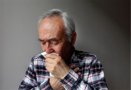 people coughing or sneezing - Older man coughing into napkin Stock Photo - Premium Royalty-Free, Code: 649-06164529