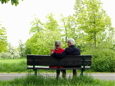 people sitting on bench - Older couple sitting on park bench Stock Photo - Premium Royalty-Free, Code: 649-06164557