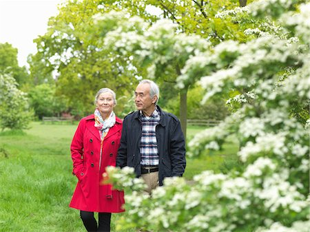 senior lady walking - Older couple walking together in park Stock Photo - Premium Royalty-Free, Code: 649-06164550