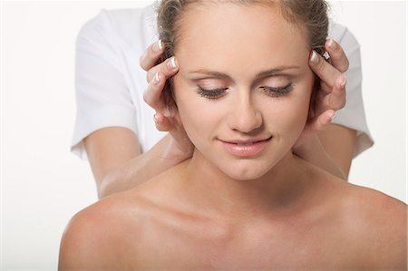 self indulgence - Smiling woman having scalp massage Stock Photo - Premium Royalty-Free, Code: 649-06164622