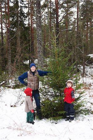 snow christmas tree white - Family picking Christmas tree outdoors Stock Photo - Premium Royalty-Free, Code: 649-06164680