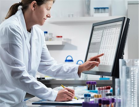 Scientist using computer in lab Stock Photo - Premium Royalty-Free, Code: 649-06164787