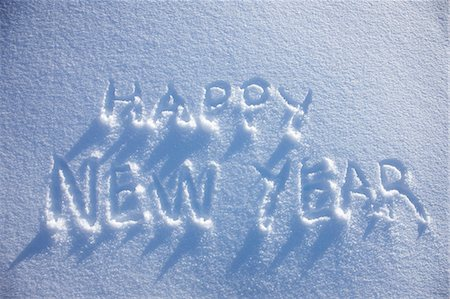 Happy New Year written in snow Stock Photo - Premium Royalty-Free, Code: 649-06164803