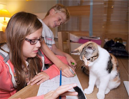 preteen girl pussy - Children with cat during homework Stock Photo - Premium Royalty-Free, Code: 649-06164834