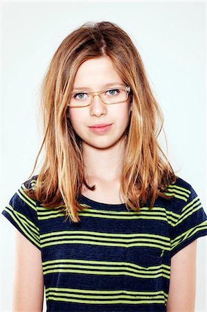 preteen beauty - Smiling girl wearing glasses Stock Photo - Premium Royalty-Free, Code: 649-06164832