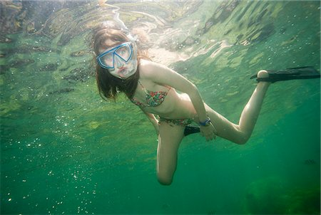 preteen swim - Girl snorkeling in tropical waters Stock Photo - Premium Royalty-Free, Code: 649-06164858