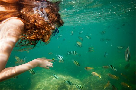 red hair preteen girl - Girl snorkeling in tropical waters Stock Photo - Premium Royalty-Free, Code: 649-06164859
