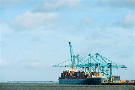 ships at sea - Container ship docked at harbor Stock Photo - Premium Royalty-Free, Code: 649-06164891