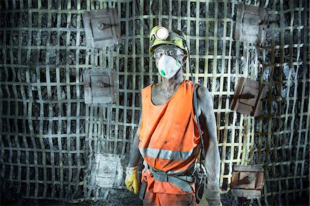 people working coal mines - Coal miner standing in mine Stock Photo - Premium Royalty-Free, Code: 649-06164918