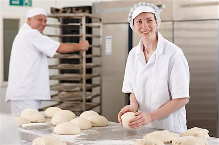 Chef baking in kitchen Stock Photo - Premium Royalty-Free, Code: 649-06165014