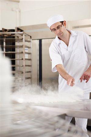 Chef baking in kitchen Stock Photo - Premium Royalty-Free, Code: 649-06165010