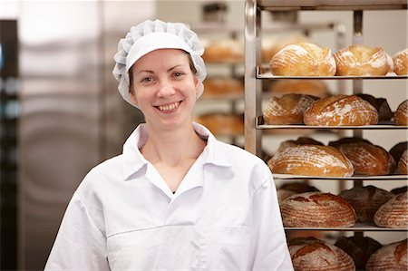 Smiling chef standing in kitchen Stock Photo - Premium Royalty-Free, Code: 649-06165025
