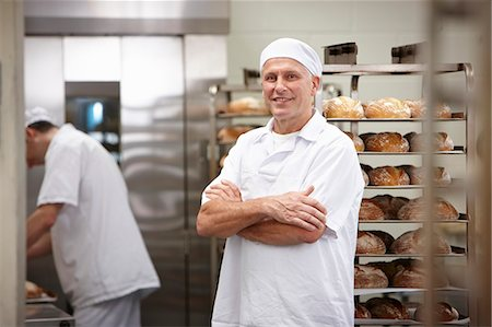 Smiling chef standing in kitchen Stock Photo - Premium Royalty-Free, Code: 649-06165023