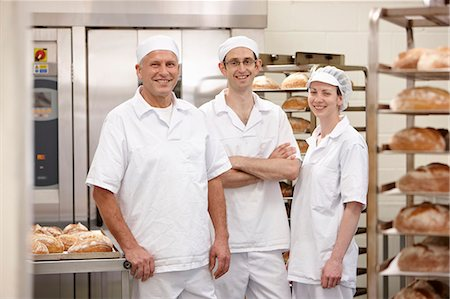 Chefs smiling together in kitchen Stock Photo - Premium Royalty-Free, Code: 649-06165030