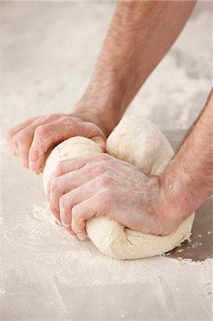 Chef kneading dough in kitchen Stock Photo - Premium Royalty-Free, Code: 649-06165046
