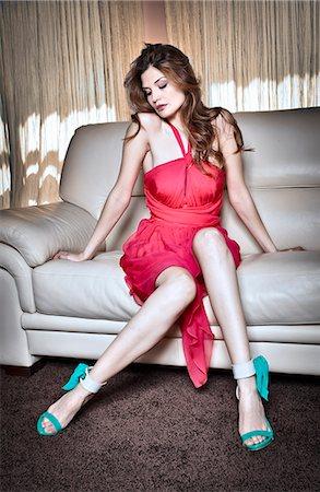 sexi women full body - Woman in cocktail dress sitting on couch Stock Photo - Premium Royalty-Free, Code: 649-06165190