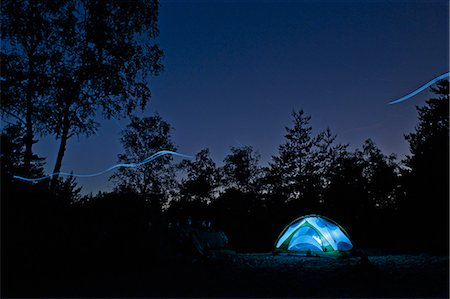 Glowing lights in tent at campsite Stock Photo - Premium Royalty-Free, Code: 649-06165308