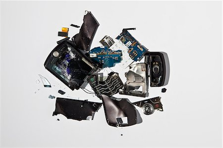 Pile of smashed cell phone parts Stock Photo - Premium Royalty-Free, Code: 649-06165317